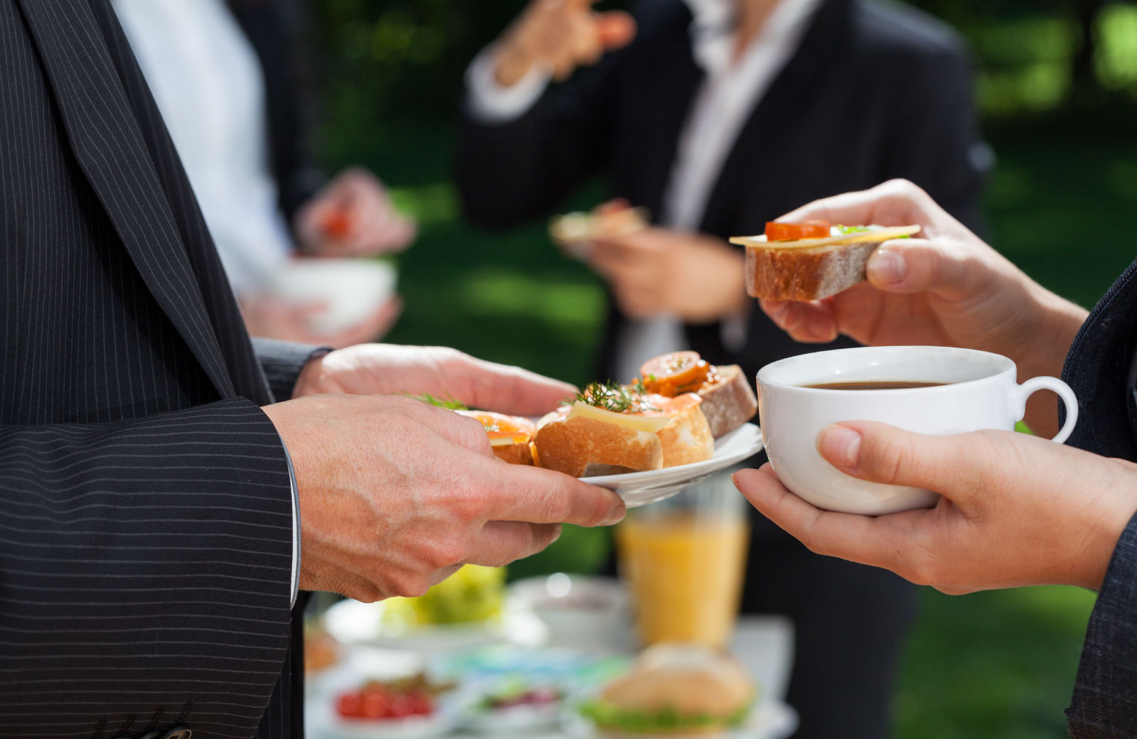 people eating bread and cheese at a party