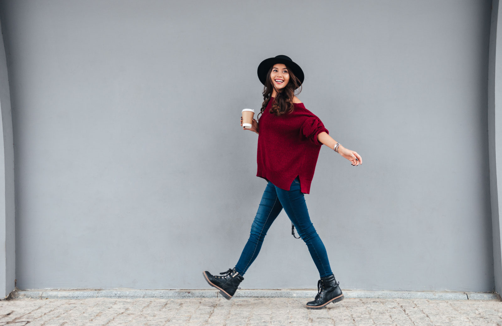 woman strolling with coffee in hand