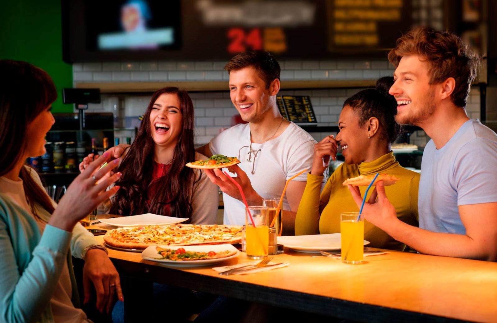 group of friends enjoying pizza
