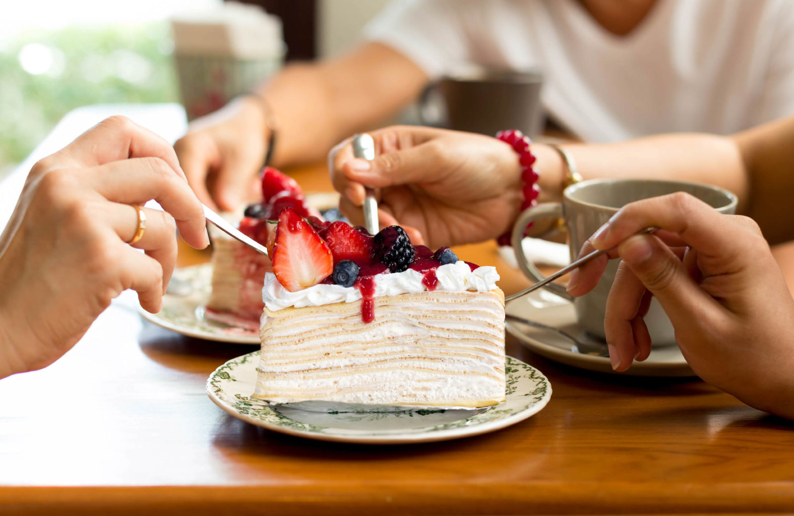 people sharing a slice of cake