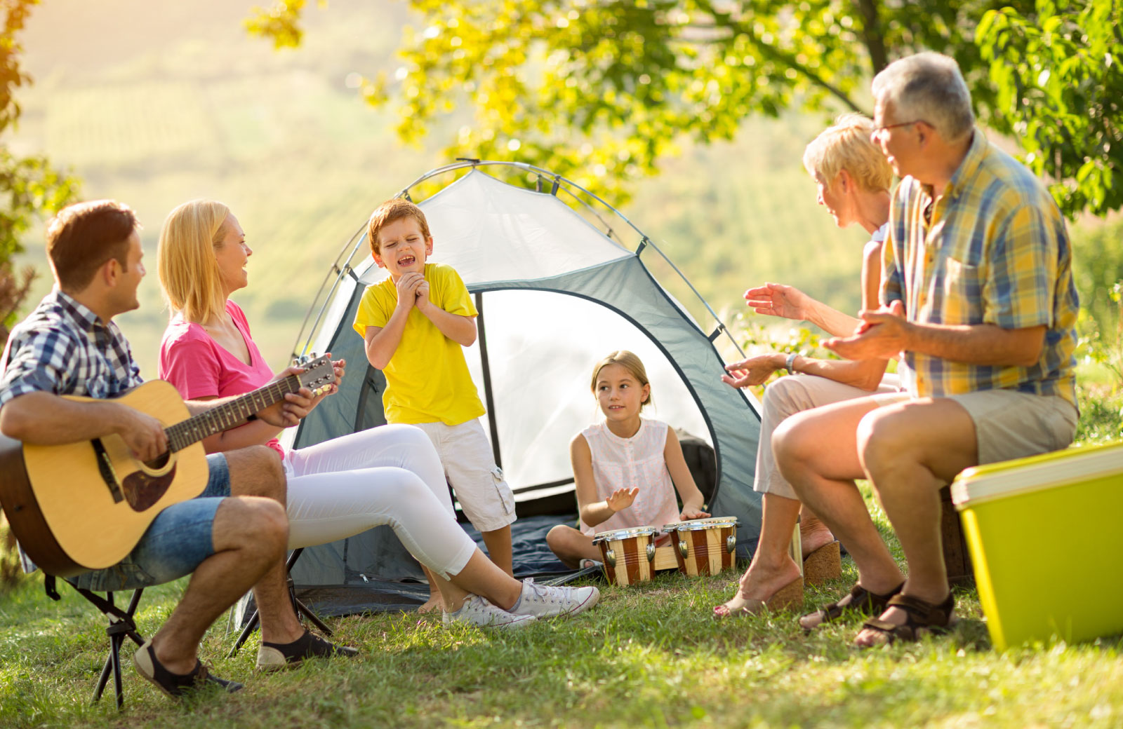 family in campgrounds with tent