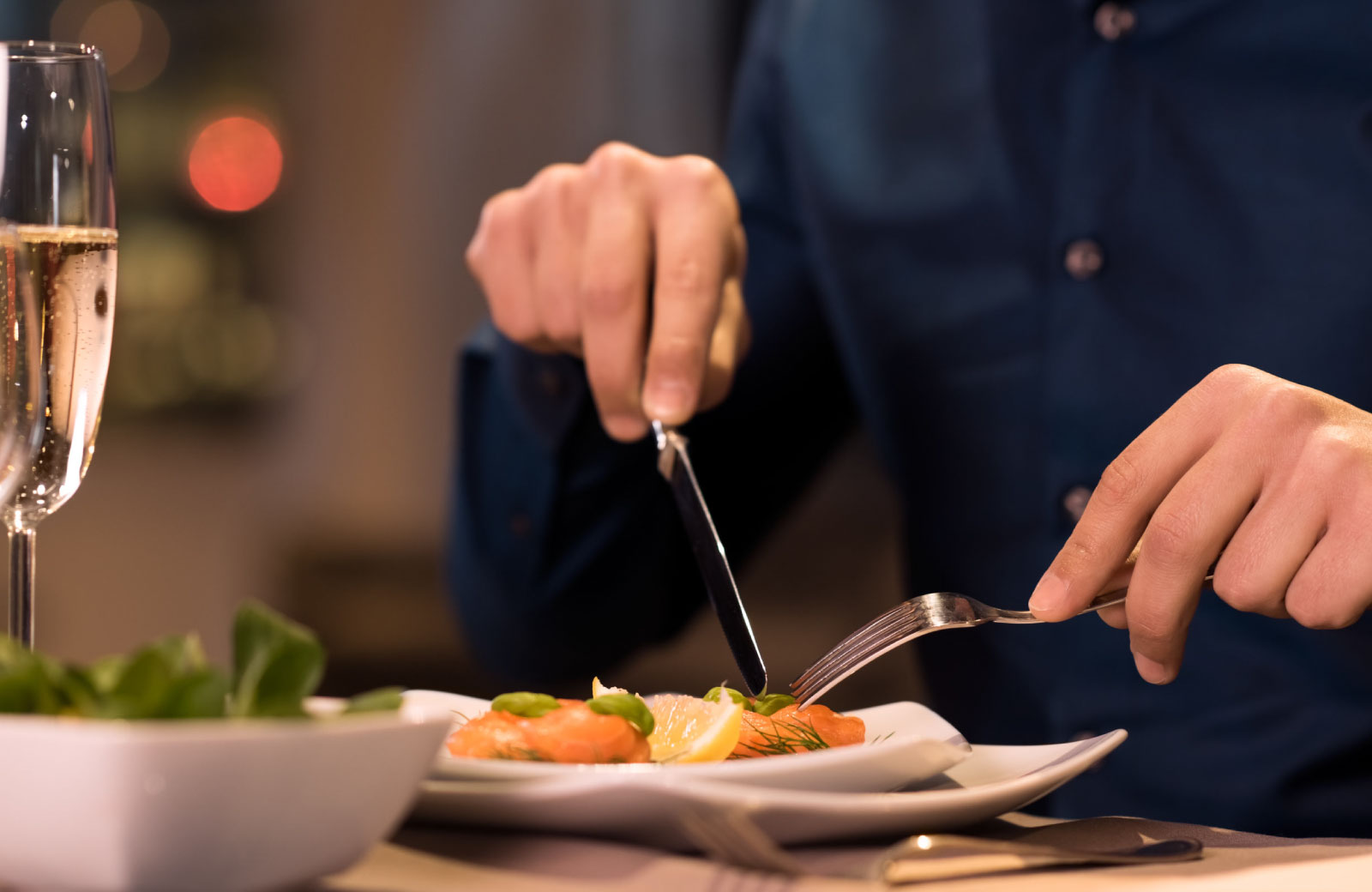 person eating with knife and fork