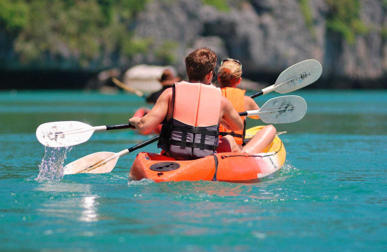 man and woman on kayak