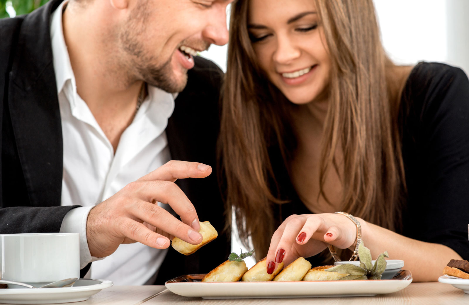 couple sharing food in a restaurant